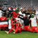DOHA, QATAR - JUNE 19: Sudan players pose for a photo as they celebrate victory following the FIFA Arab Cup Qatar 2021 Qualifiers match between Libya and Sudan at Khalifa International Stadium on June 19, 2021 in Doha, Qatar. (Photo by Mohamed Farag - FIFA/FIFA via Getty Images)