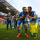 LODZ, POLAND - JUNE 15: Kyrylo Dryshliuk of Ukraine (L) and Oleksiy Khakhlov of Ukraine celebrate with the FIFA U-20 World Cup trophy following their sides victory in the 2019 FIFA U-20 World Cup Final between Ukraine and Korea Republic at Lodz Stadium on June 15, 2019 in Lodz, Poland. (Photo by Lars Baron - FIFA/FIFA via Getty Images)