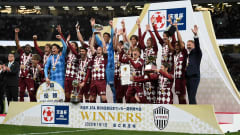 TOKYO, JAPAN - JANUARY 01: Andres Iniesta #8 holds the trophy aloft during the trophy presentation of the 99th Emperor's Cup final between Vissel Kobe and Kashima Antlers at the National Stadium on January 01, 2020 in Tokyo, Japan. (Photo by Matt Roberts/Getty Images)