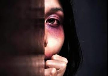 Abused woman hiding in dark. (Rudyanto Wijaya, Jupiter Images)