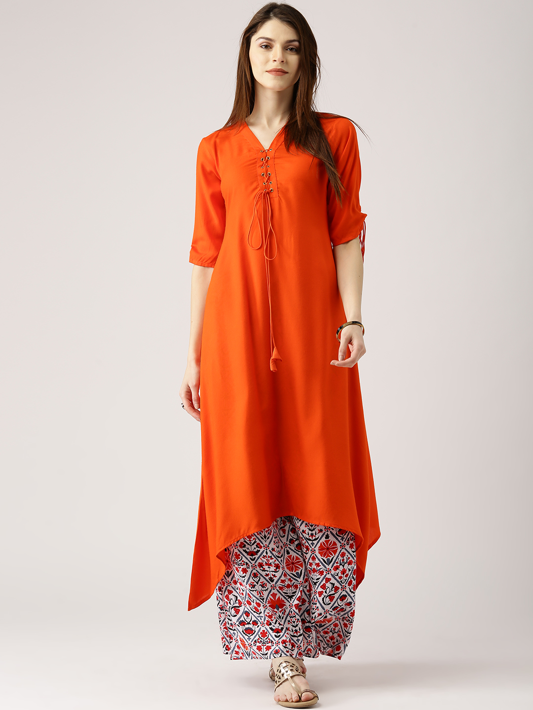 26936740414 Buy Libas Women Orange   White Solid A-Line Kurta with Palazzos ...