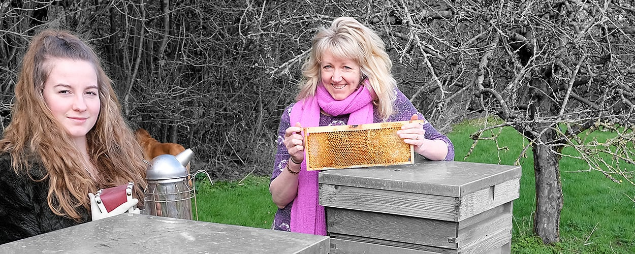 Neve and Julie of Neve's Bees with beehives