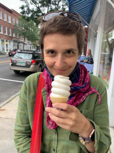 The author of the article eating maple creemee, a vermont soft serve maple ice cream