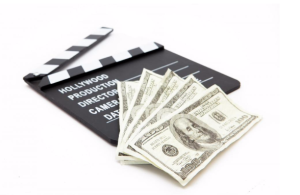 Stock image of money and a film clapperboard