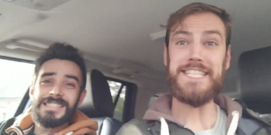 Screenshot of John and Tyler in a car looking happy