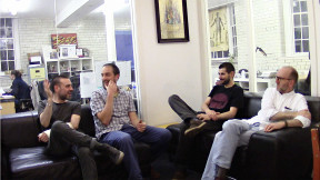"""The guys are all together in the """"Story Cube"""" at Once Were Farmers Studio having a development meeting."""