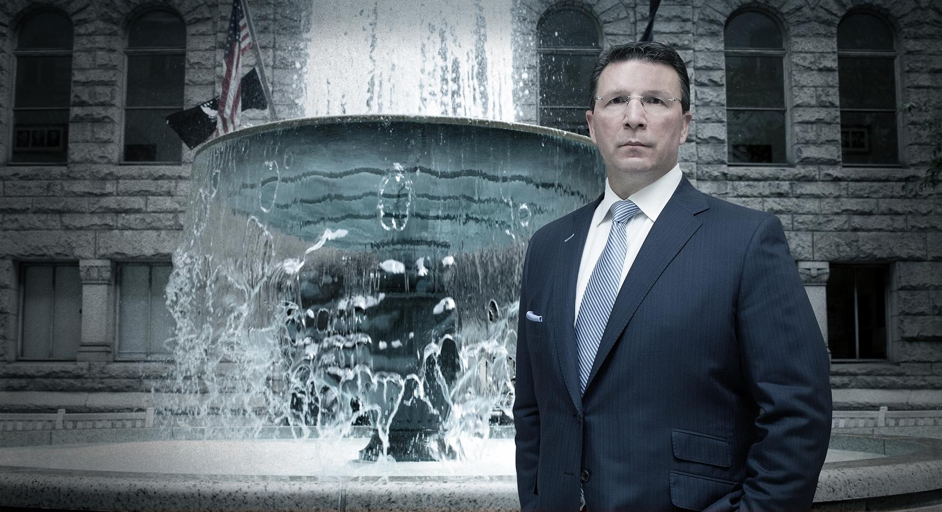 Lawyer Standing In Front of Fountain