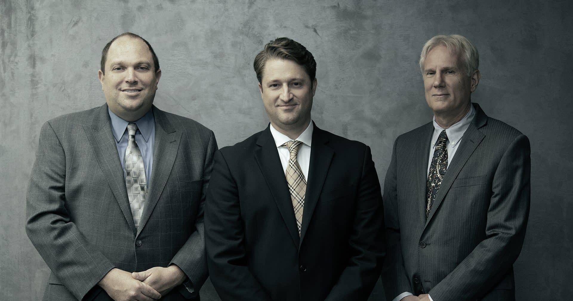 3 men standing outside