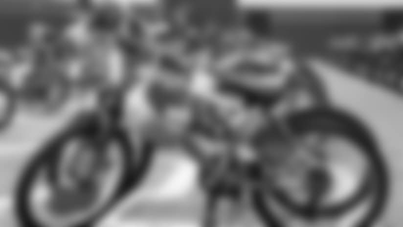 Broncos spread Christmas cheer by gifting bikes to 90 Boys & Girls Club kids