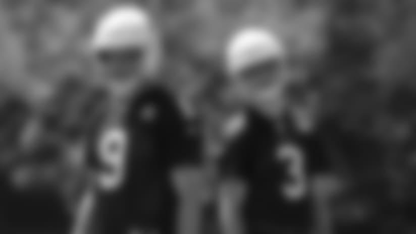 Quarterbacks Sam Bradford (9) and Josh Rosen work at a recent OTA.