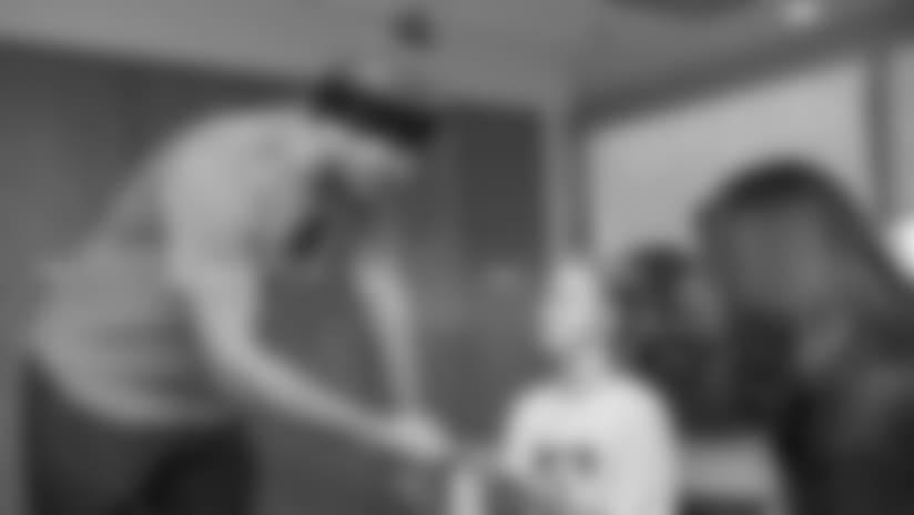 Watch: Greg Olsen distributes new beanies