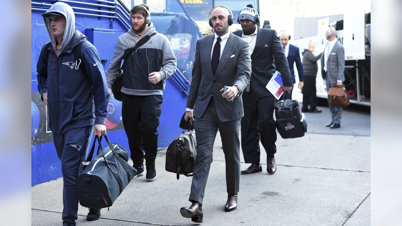 New England Patriots quarterback Brian Hoyer, center, arrives at New Era Field prior to an NFL football game against the Buffalo Bills, Sunday, Dec. 3, 2017, in Orchard Park, N.Y. (AP Photo/Rich Barnes)
