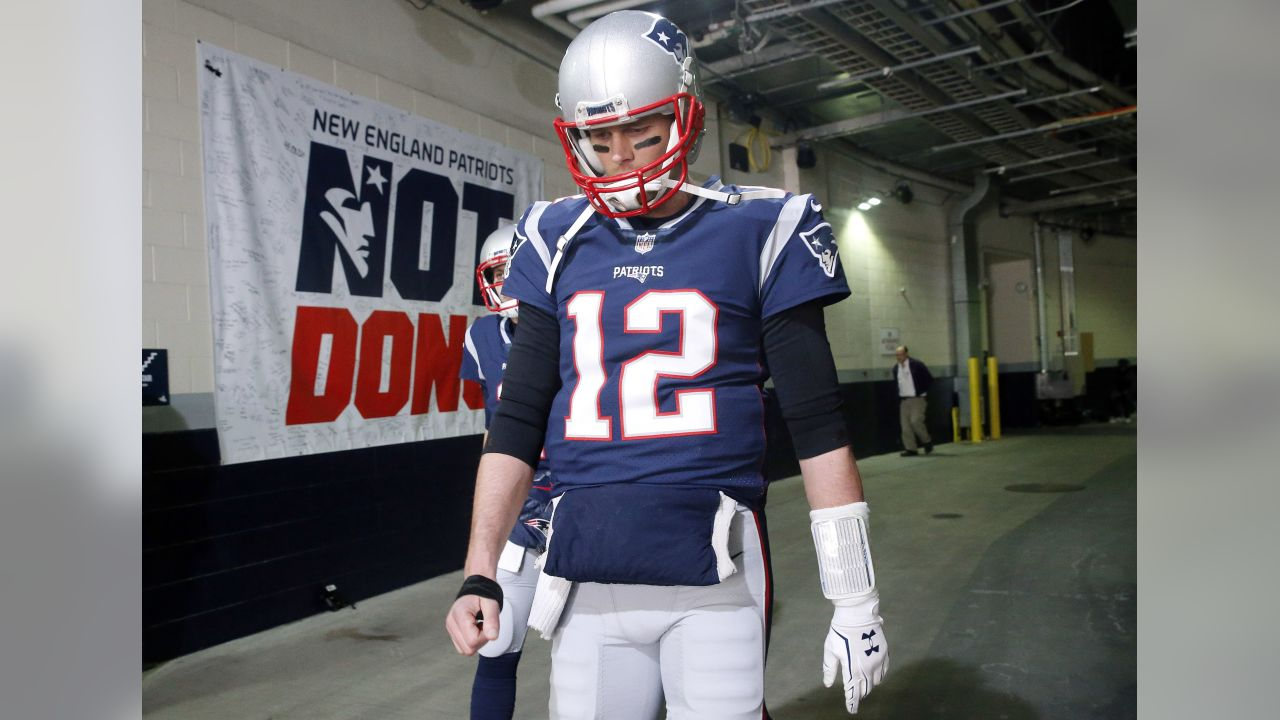 New England Patriots quarterback Tom Brady walks toward the field to warm up before the AFC championship NFL football game against the Jacksonville Jaguars, Sunday, Jan. 21, 2018, in Foxborough, Mass. (AP Photo/Winslow Townson)