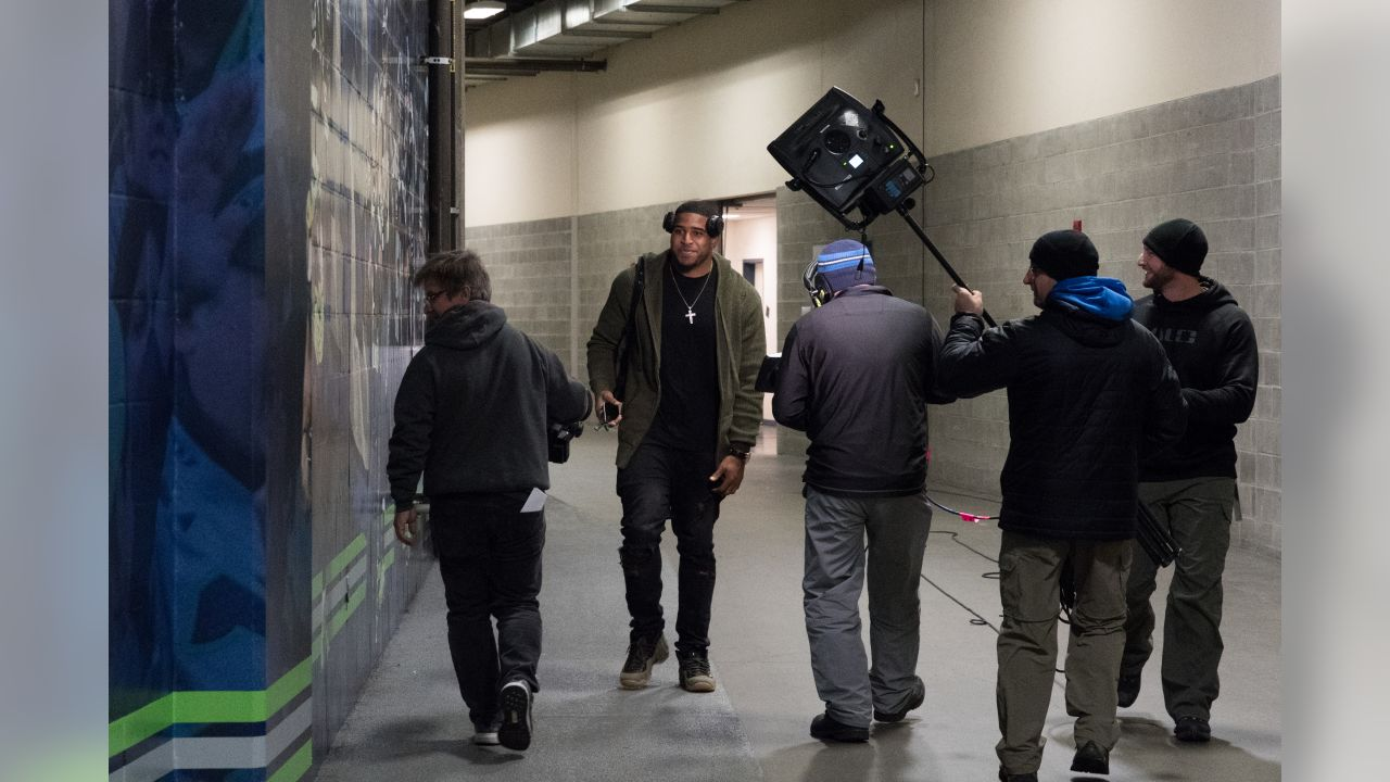 Bobby Wagner arrives at CenturyLink Field trailed by the Thursday Night Football camera crew before the game.