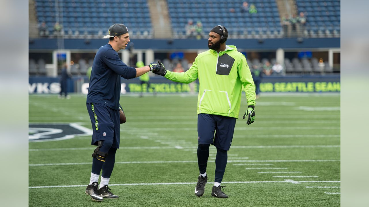 Tight ends Luke Willson and Marcus Lucas shake hands during early warmups prior to the Monday Night Football game against the visiting Buffalo Bills.
