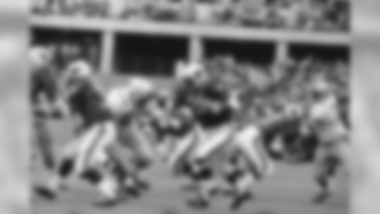 1970: Cardinals RB Cid Edwards carries the ball against the Oilers