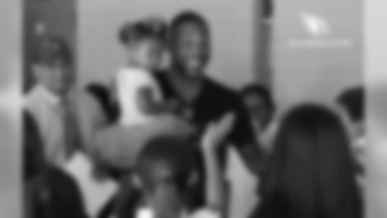 CB Patrick Peterson hangs out with the students while holding his daughter, Paityn
