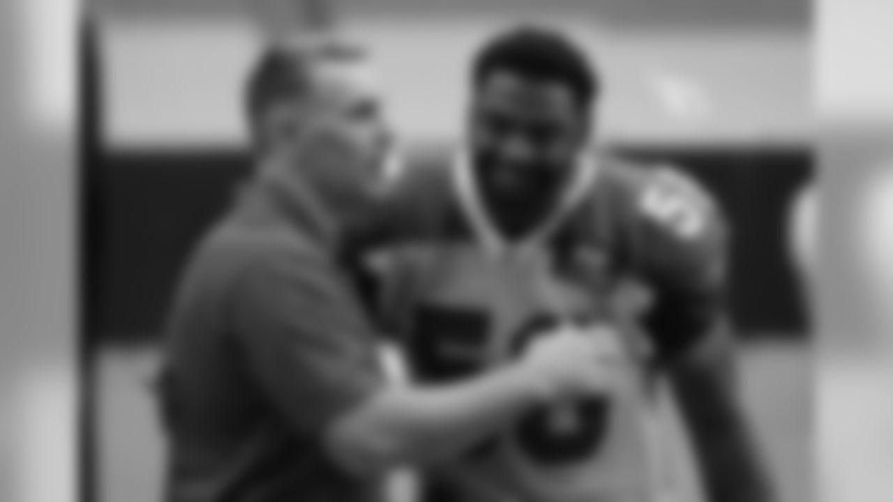 Hall of Famer/NFL Network reporter/former Cardinals quarterback Kurt Warner gets a welcome hug from former teammate Karlos Dansby