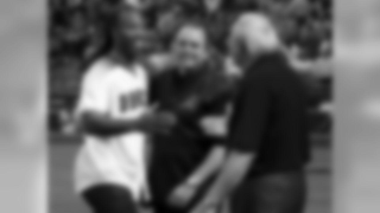 From left: Larry Fitzgerald, Derrick Hall and Ken Kendrick