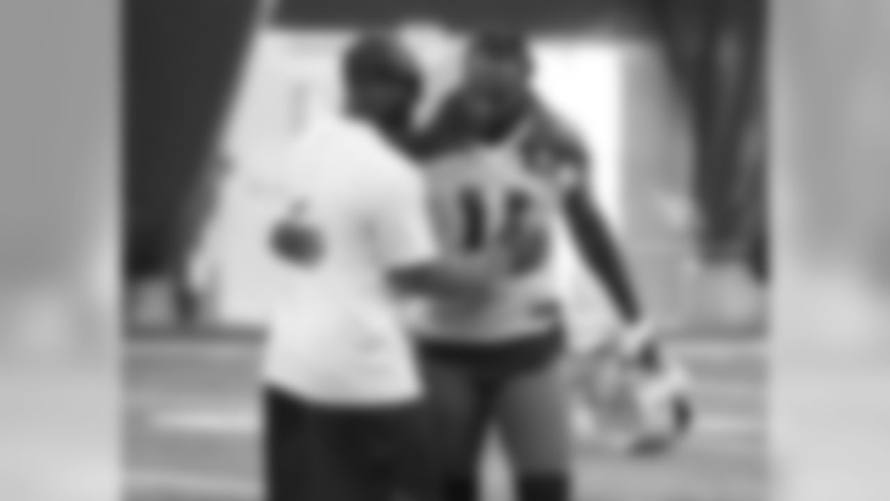 Larry Fitzgerald hugs hello with Torry Holt