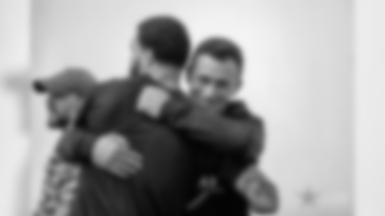 Former Texas A&M University Aggies quarterback Johnny Manziel hugs former teammate Tampa Bay Buccaneers wide receiver Mike Evans (13) during Texas A&M Pro Day at the NCAA football team's indoor training facility on Tuesday, March 27, 2018 in College Station, Texas. (Aaron M. Sprecher via AP)