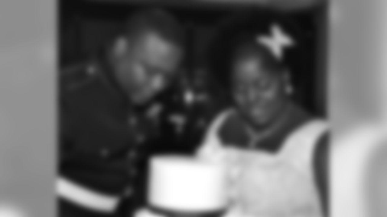 Lance Cpl Omoro Z. Mitchell on his wedding day with wife, Erikka.