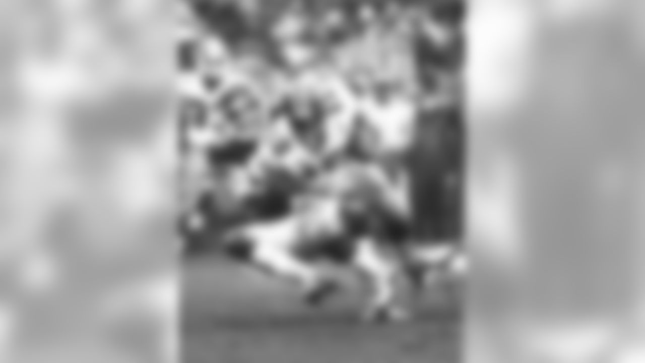 Soon-to-be-inducted Ring of Honor member Marty Lyons does what he does best, dragging QB Steve Bartowski for a sack in the 27-21 loss to the Falcons on 10/23/83.