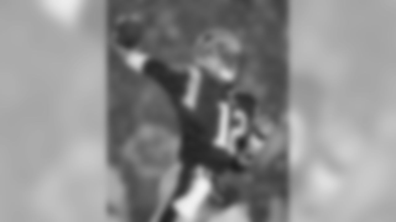 Jan. 19, 2002. AFC Divisional Round.Patriots 16, Raiders 13 OT.Brady: 32-of-52, 312 yards, 1 INT, 1 Rush TD.
