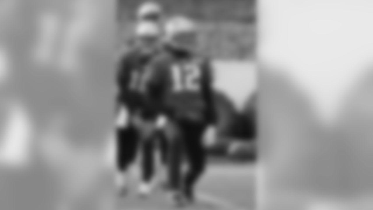 New England Patriots quarterbacks Tom Brady (12), Jimmy Garoppolo, left, and Jacoby Brissett, behind, warm up during an NFL football practice, Thursday, Jan. 5, 2017, in Foxborough, Mass. (AP Photo/Steven Senne)