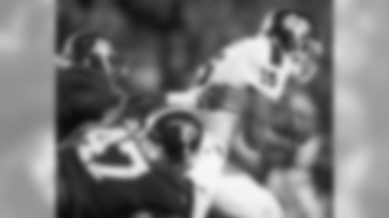 Mississippi State quarterback Dak Prescott (15) is taken down by Alabama linebacker Xzavier Dickson (47) and Alabama defensive lineman A'Shawn Robinson (86) during the second half of an NCAA college football game Saturday, Nov. 15, 2014, in Tuscaloosa, Ala. Alabama won 25-20. (AP Photo/Brynn Anderson)