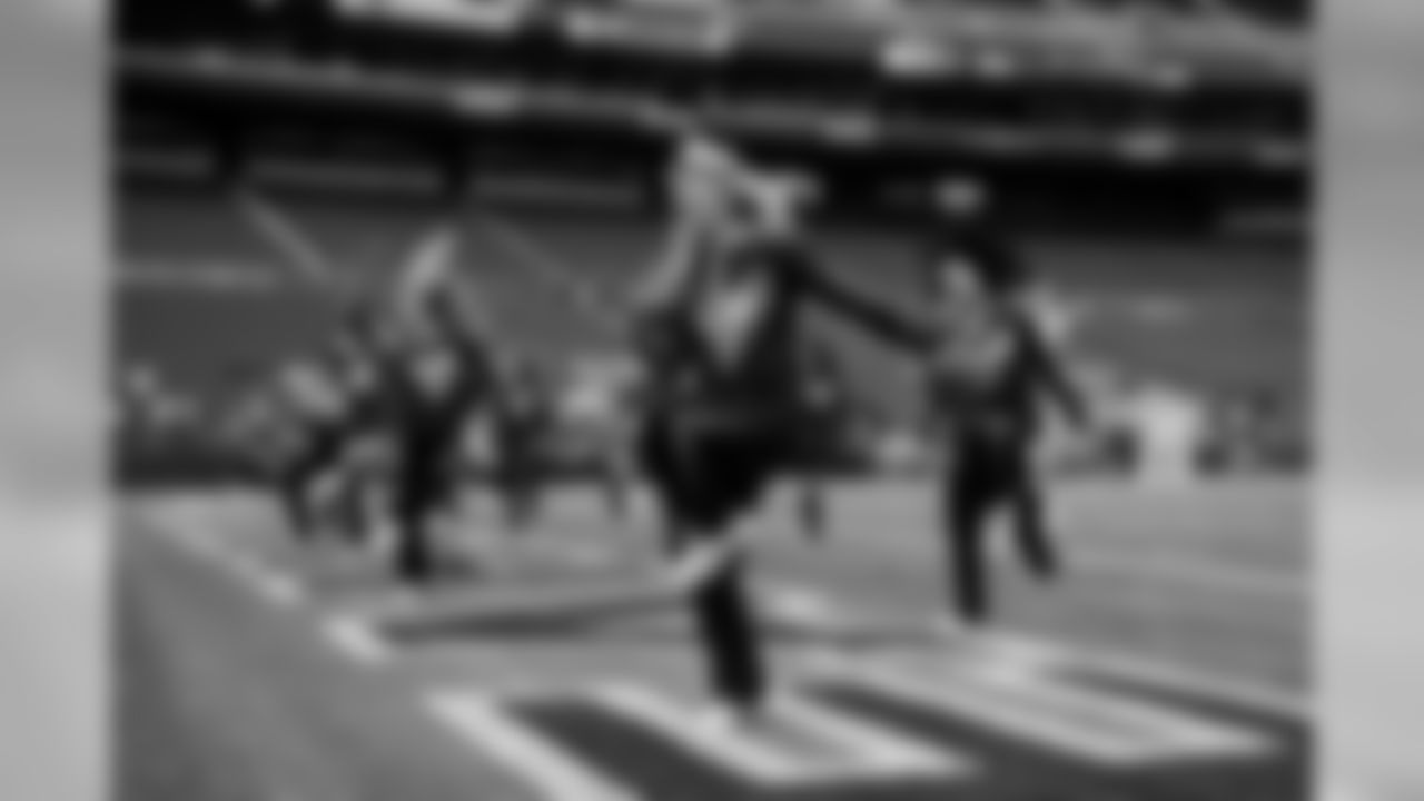 Hours before kickoff and in an empty stadium, the Sea Gal Kylie and the rest of the team rehearse on the field.