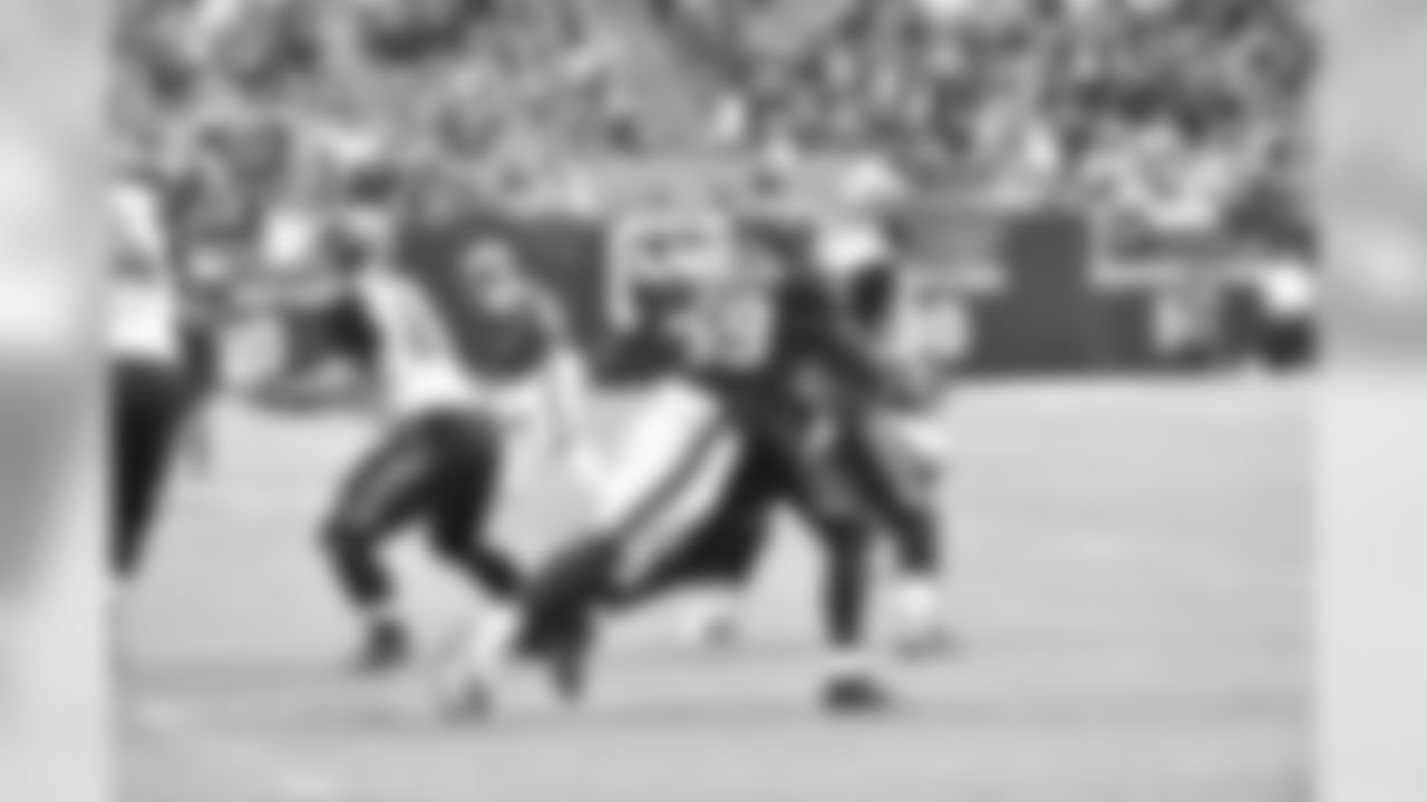 Whitney Mercilus hugs a Jacksonville Jaguar.