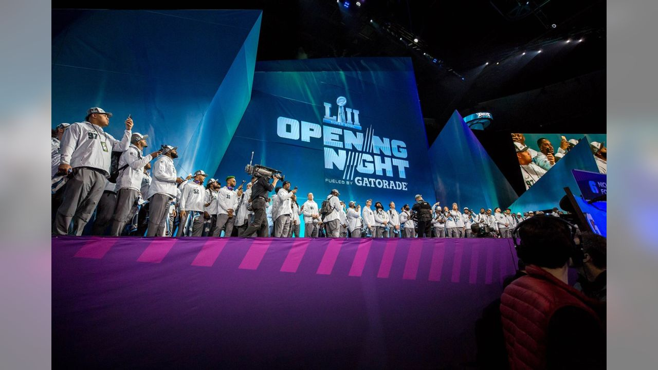 The Philadelphia Eagles players walk out on stage during Super Bowl Opening Night.