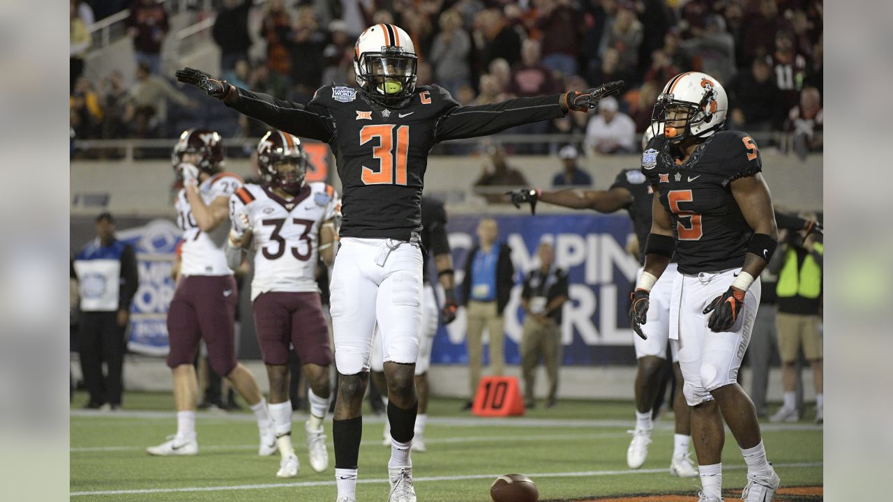 Oklahoma State safety Tre Flowers (31) reacts after a Virginia Tech incompletion in the end zone during the second half of the Camping World Bowl NCAA college football game Thursday, Dec. 28, 2017, in Orlando, Fla. Oklahoma State won 30-21. (AP Photo/Phelan M. Ebenhack)
