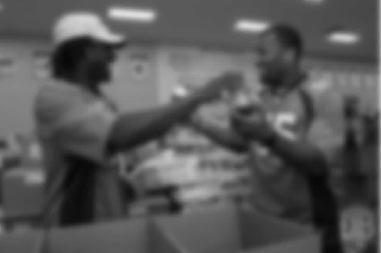 Cornerback Isaac Yiadom (41) and outside linebacker Bradley Chubb (55) laugh while packing food at the Food Bank of the Rockies at the Broncos' third annual Rookie Community Service Day on June 11, 2018.