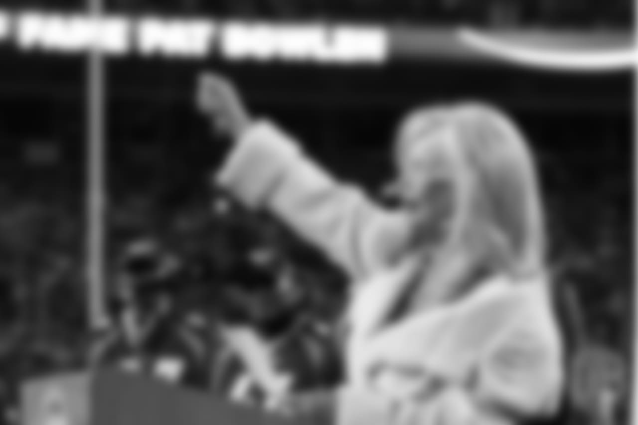 Annabel Bowlen finishes her speech with a flourish during Ring of Fame induction ceremonies for her husband, Broncos Owner Pat Bowlen, on Nov. 1, 2015.