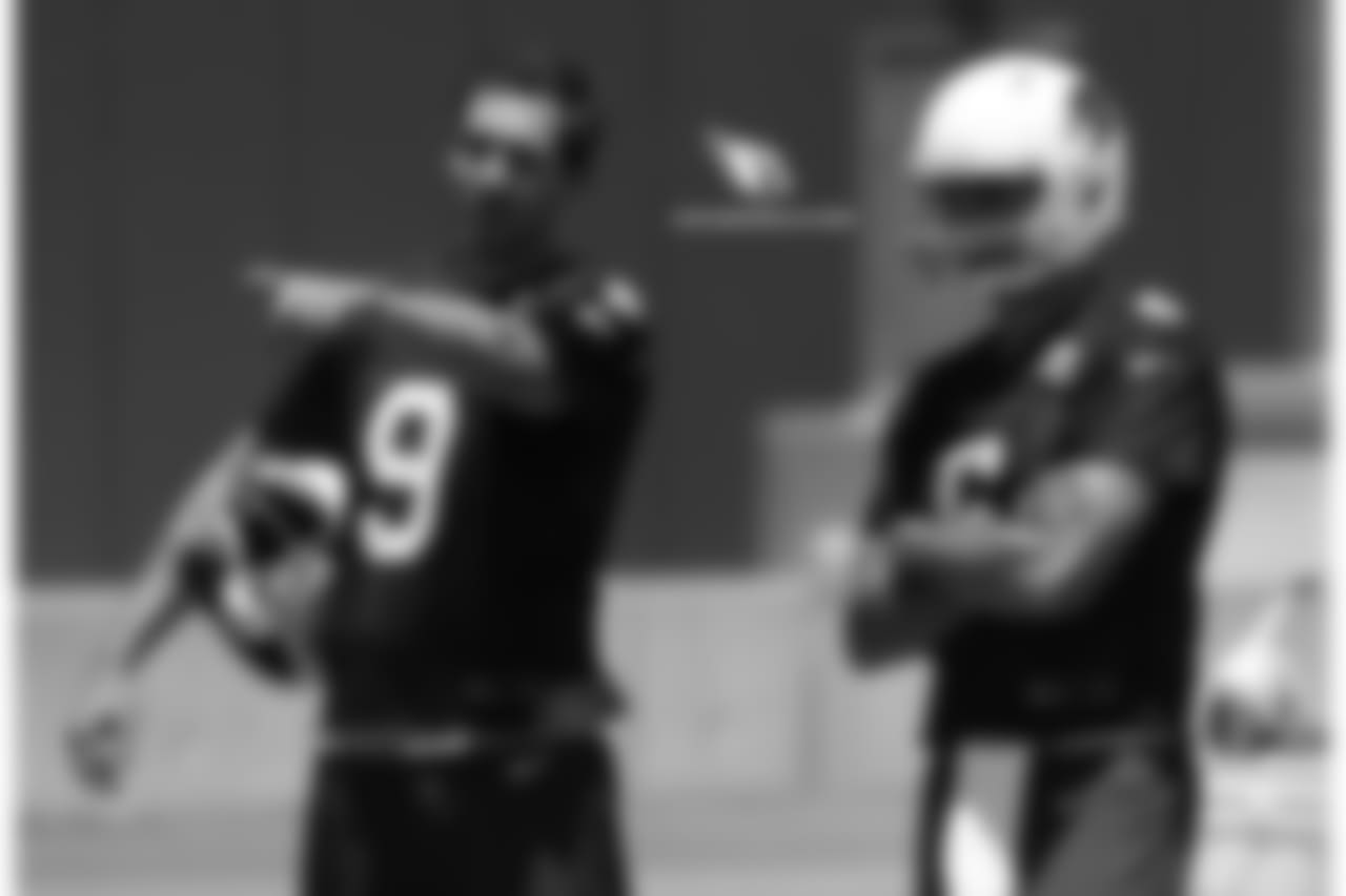 QB Sam Bradford (left) gives advice to QB Chad Kanoff