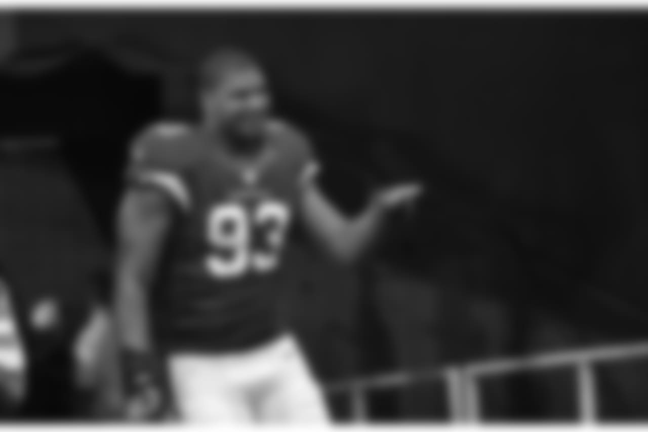 DT Calais Campbell walking onto the field before the 2016 opener