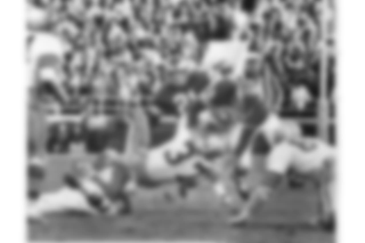 Maxie Baughan lays down a hard hit at Franklin Field in 1964.