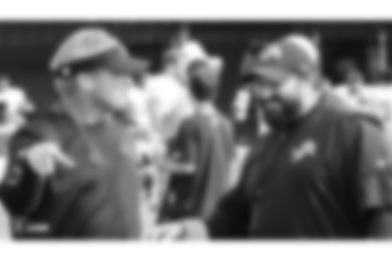 Oakland Raiders head coach Jon Gruden talking to head coach of the Detroit Lions Matt Patricia on the field for practice at 2018 Training Camp at The Oakland Raiders Napa Valley Training Complex, Monday, August 7, 2018, in Napa, California.