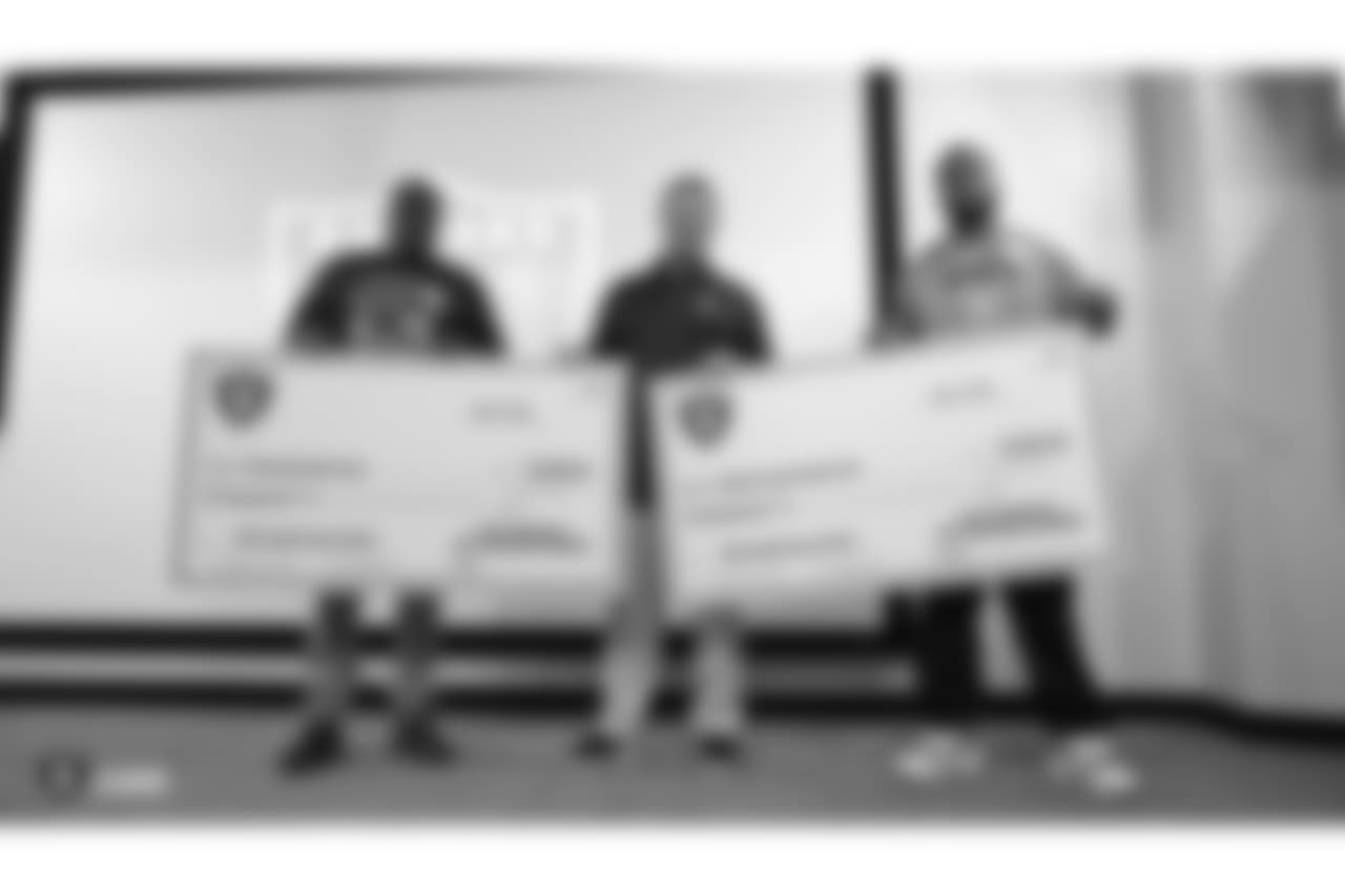 The Oakland Raiders and head coach Jon Gruden each match a $5000 donation by Dicks Sporting Goods Foundation's Sports Matters to both Oakland Tech High School and McClymonds High School's football programs. Accepting the donations were Oakland Tech High School's head coach Virdell Larkins Jr. and McClymonds High School's head coach Michael Peters, at the Oakland Raiders Practice Facility, Tuesday, July 17, 2018, in Alameda, California.