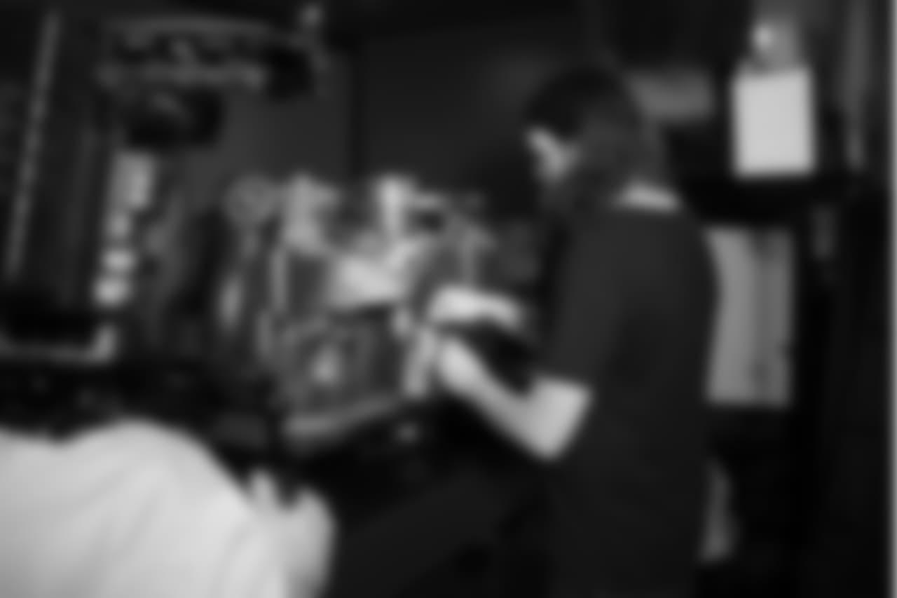 Latte artist Kale Lotton works on the Seahawks schedule release video.