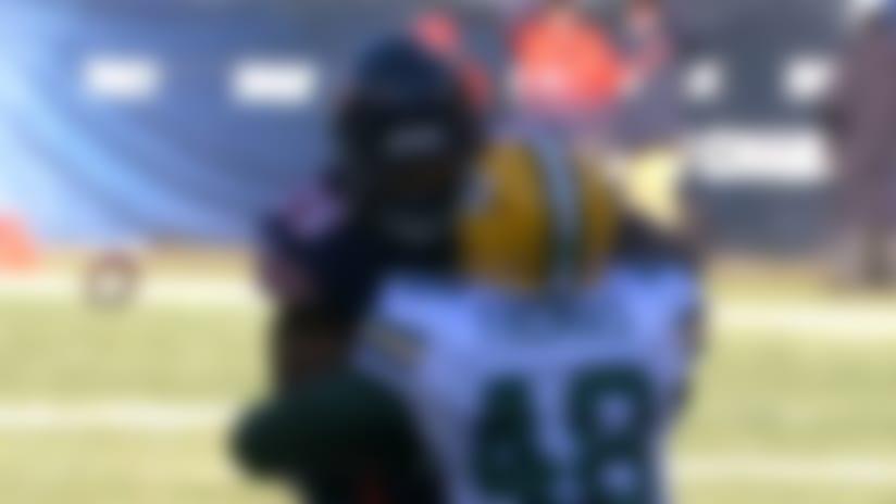 Bears logo flies off Ka'Deem Carey's helmet after hit