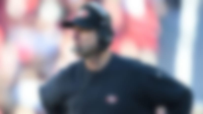 Niners win in Harbaugh's last game