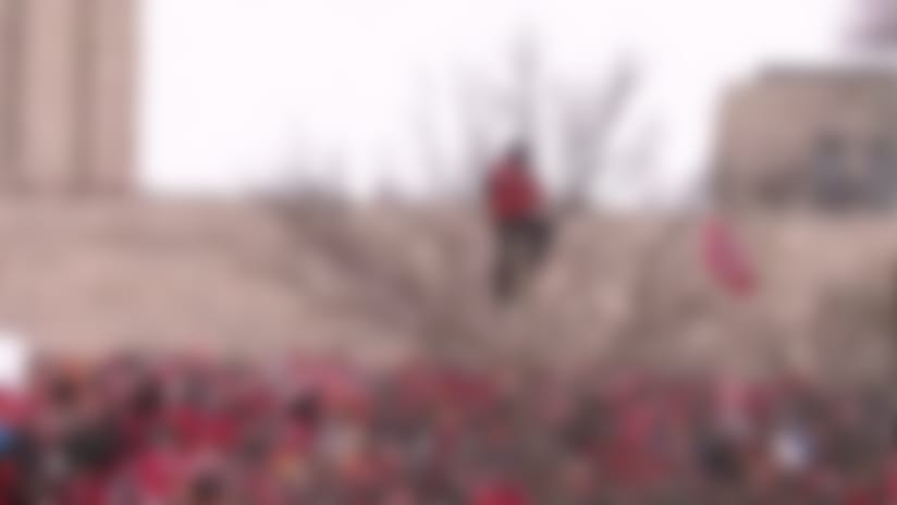 Fan watches Kansas City Chiefs' Super Bowl LIV victory parade from a tree