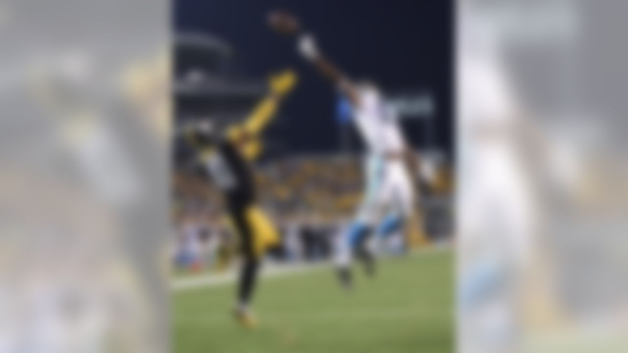 Carolina Panthers wide receiver Devin Funchess (17) can't reach a pass that goes over him and Pittsburgh Steelers defensive back Antwon Blake (41) during the second quarter of an NFL preseason football game, Thursday, Sept. 3, 2015, in Pittsburgh.