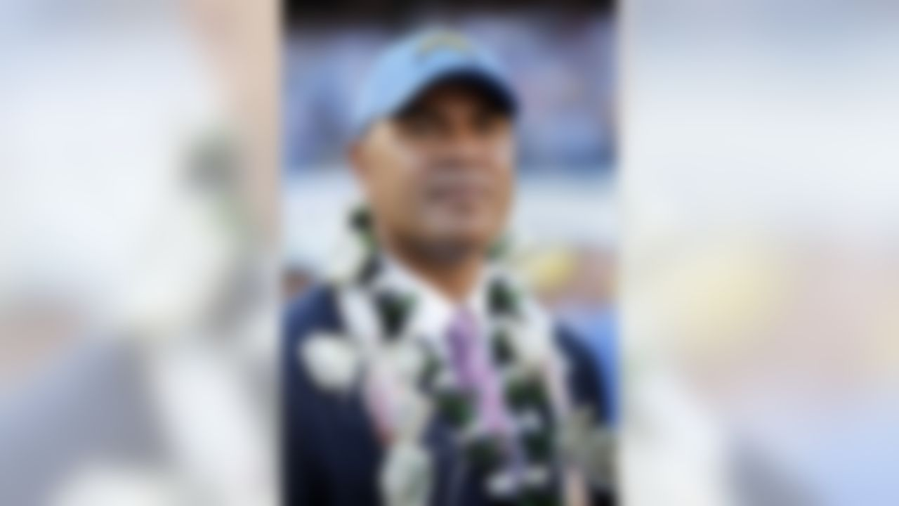 Former San Diego Chargers linebacker Junior Seau wears a lei at a halftime ceremony inducting him into the Chargers Ring of Honor during the NFL week 12 football game against the Denver Broncos on Sunday, November 27, 2011 in San Diego, California. The Broncos won the game in overtime 16-13. (AP Photo/Paul Spinelli)