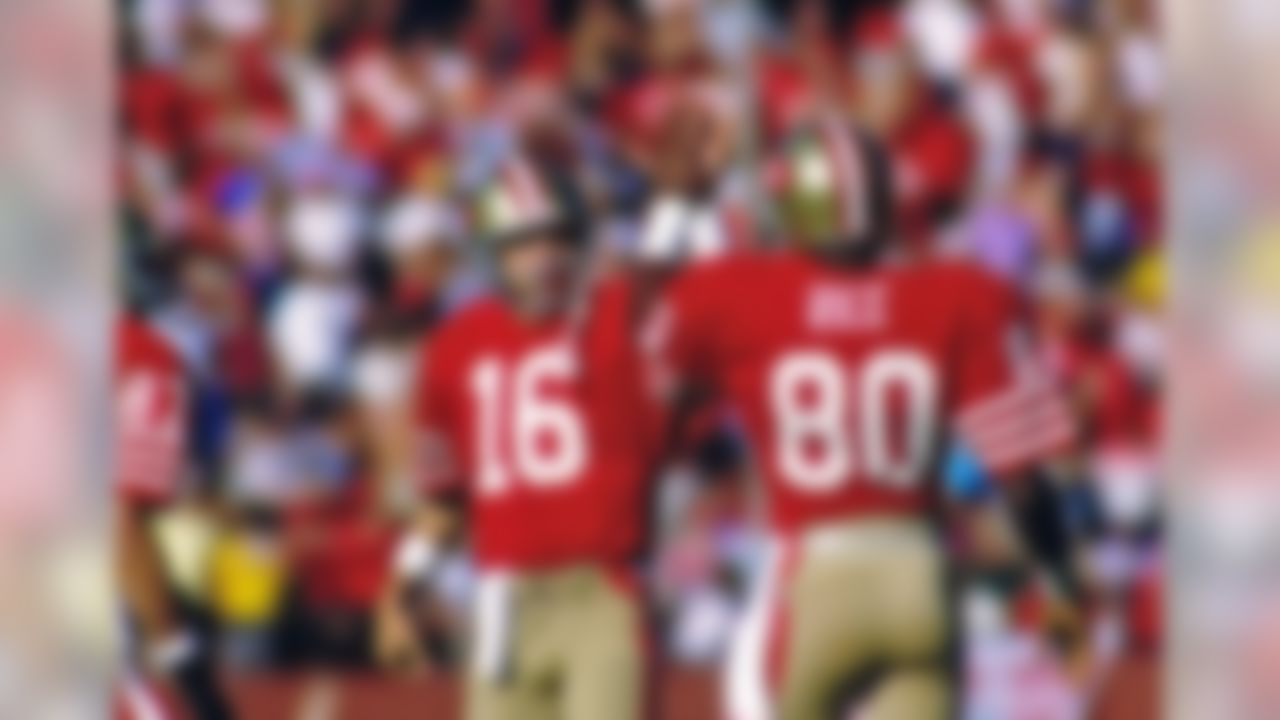San Francisco 49ers quarterback Joe Montana (16) celebrates with wide receiver Jerry Rice (80) during an NFL game against the St. Louis Cardinals Sunday, Nov. 9, 1986 in San Francisco. The 49ers won the game, 43 to 17. (Greg Trott/Associated Press)