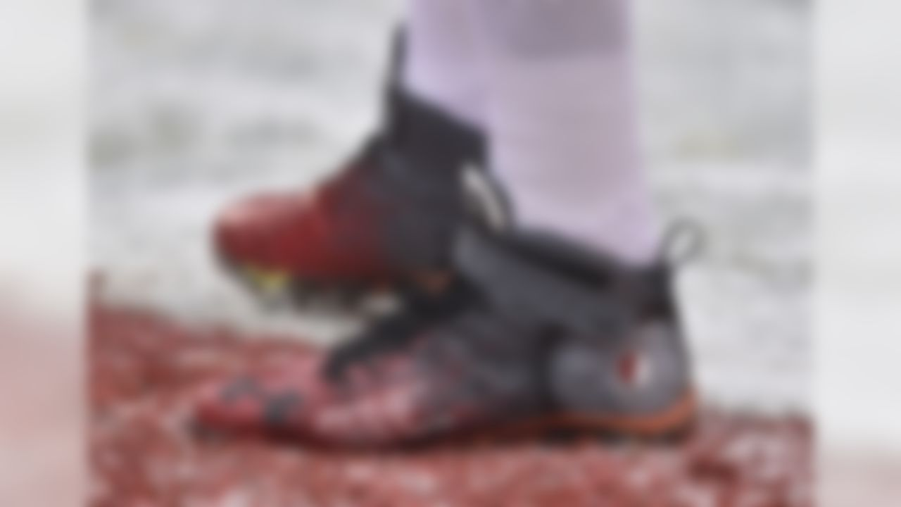 Cleveland Browns tackle Joe Thomas cleats are shown before an NFL football game between the Cincinnati Bengals and the Cleveland Browns, Sunday, Dec. 11, 2016, in Cleveland. (AP Photo/David Richard)