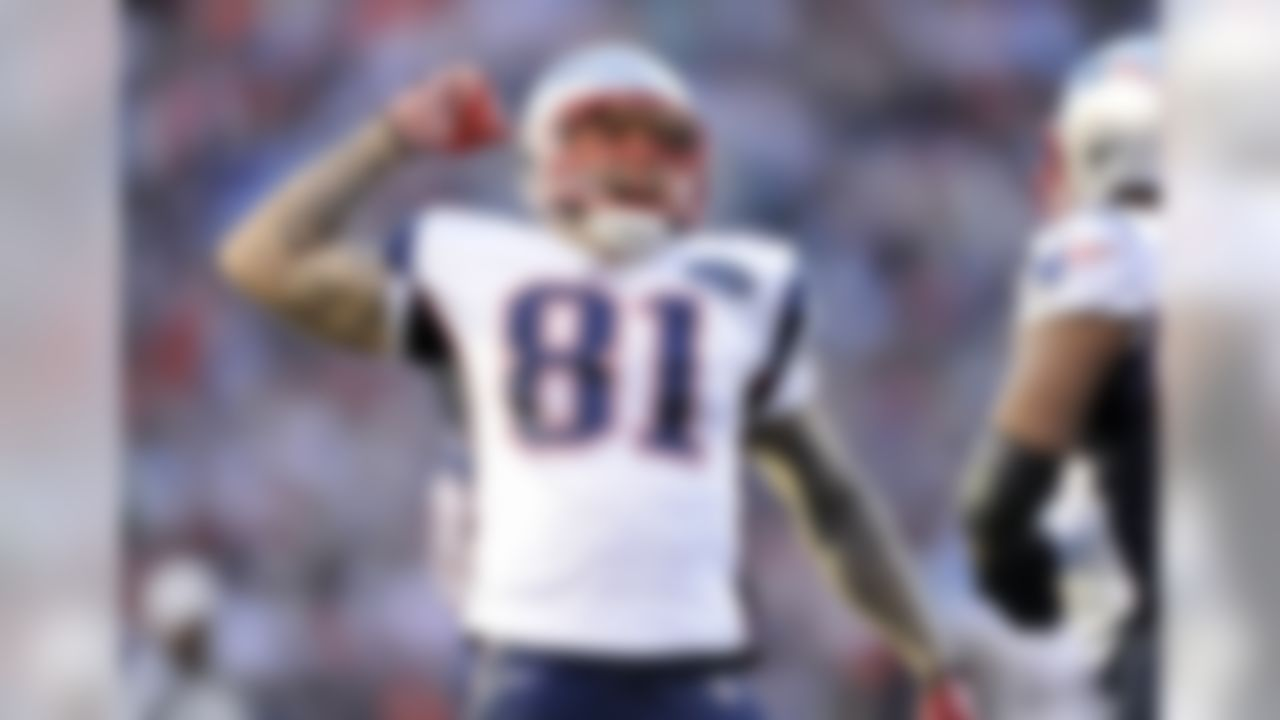 New England Patriots tight end Aaron Hernandez (81) celebrates during an NFL game against the Denver Broncos on Sunday, Dec. 18, 2011, in Denver. The Patriots won the game, 41-23.  (AP Photo/Greg Trott)